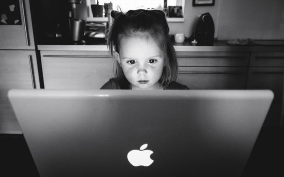 Child on a computer using technology